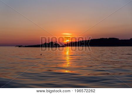 Sunset at sea in Rovinj bay Istria Croatia