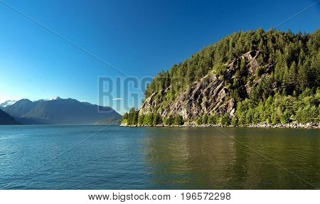 View at the cliff and mountain ridge in Porteau Cove,  coastline and forest. British Columbia Canada.