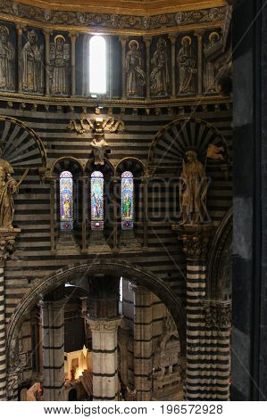 Italy Siena - December 26 2016: the view of the Siena Cathedral interior from the passageway under the roof on December 26 2016 in Siena Tuscany Italy.