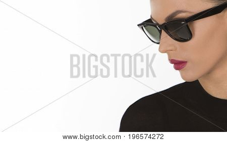 Close up shot of a girl in black fashionable sunglasses
