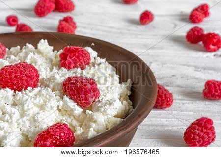 cottage cheese with fresh ripe raspberry for healthy breakfast. close up