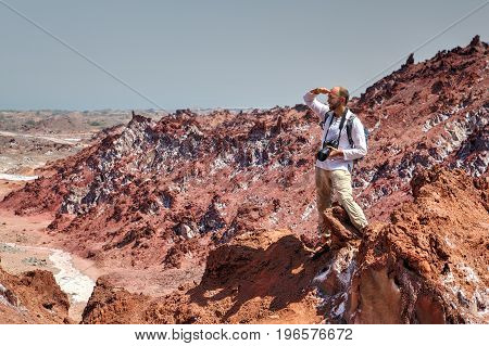 A view from under the hand Backpacker makes hiking in the salty mountains Hormuz Island Hormozgan Province Iran.