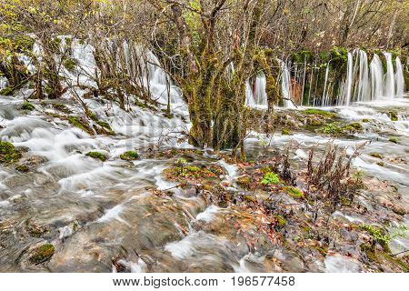 Autumn view of the waterfall with pure water. Jiuzhaigou nature reserve Jiuzhai Valley National Park China.