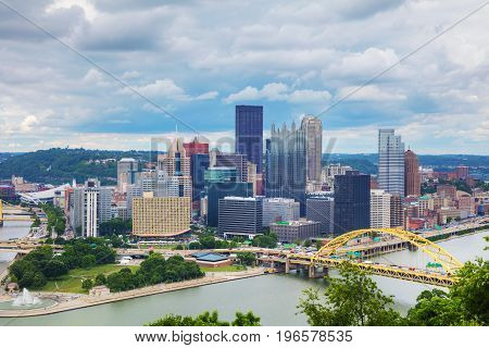 Pittsburgh cityscape with the Ohio river on a cloudy day