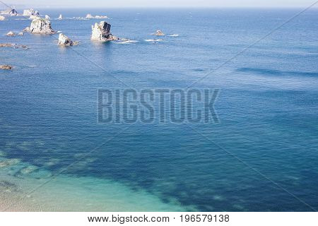 Amazing view to the ocean blue transparent water with no waves nice sunny warm summer day. Top down view no people. Perfect place for swimming with mask and see beautiful fishes and underwater world