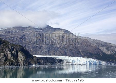 The scenic view of a glacier and mountainous landscape in Glacier Bay national park (Alaska).