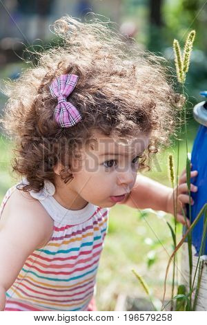 Portrait of surprised baby girl outdoors closeup