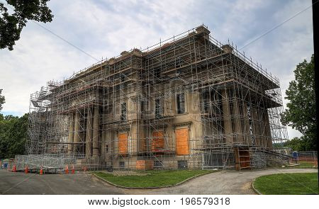 a corner view of a building being renovated with scaffolding.
