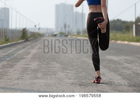 Young adult woman performs breathing exercise. Girl goes in for sports. Close up.