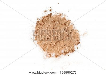 Crushed gold eye shadow isolated on the white background