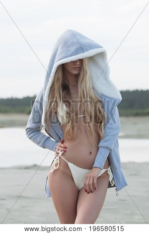 Girl in swimsuit at the sea. High fashion look.glamor beautiful sexy stylish blond. Caucasian young woman model.