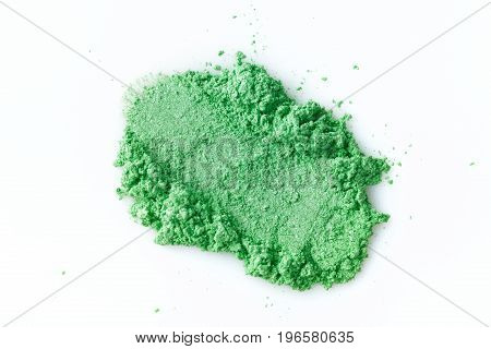 Crushed green eye shadow isolated on the white background