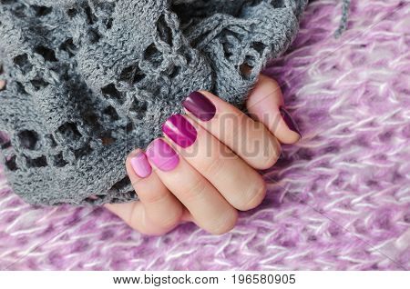 Pink nail design. Beautiful female hand with different shades of pink manicure.