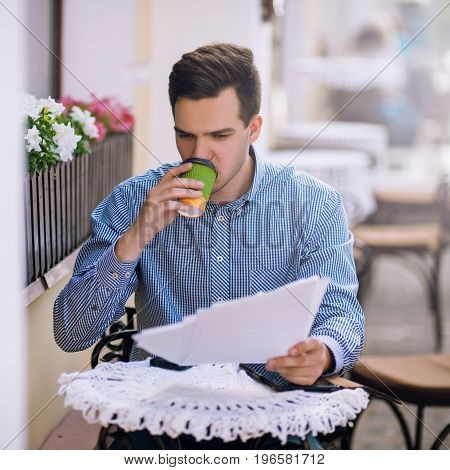 Busy workaholic working at lunchtime. Attentive businessman in cafe