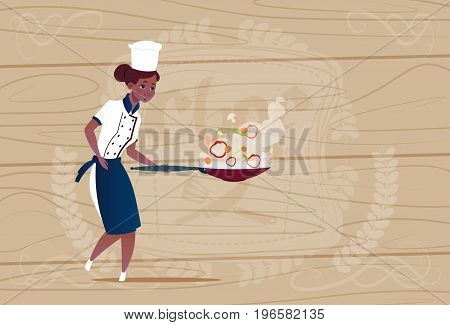 Female African American Chef Cook Holding Frying Pan Cartoon In Restaurant Uniform Over Wooden Textured Background Flat Vector Illustration