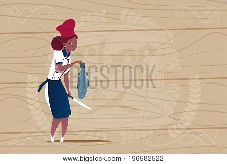 Female African American Chef Cook Holding Fish Cartoon Chief In Restaurant Uniform Over Wooden Textured Background Flat Vector Illustration