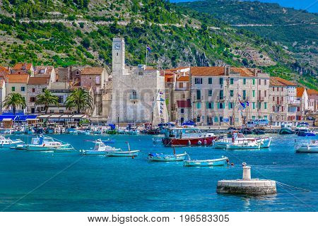 Seafront view at coastal town Komiza in south of Croatia, Island Vis.