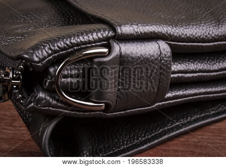 A half ring on a leather bag; Bag details; Leather texture