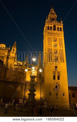 The Giralda bell tower lit up at night in Seville Spain Europe