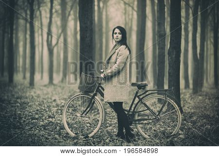 Portrait Of A Young Woman With A Bicycle