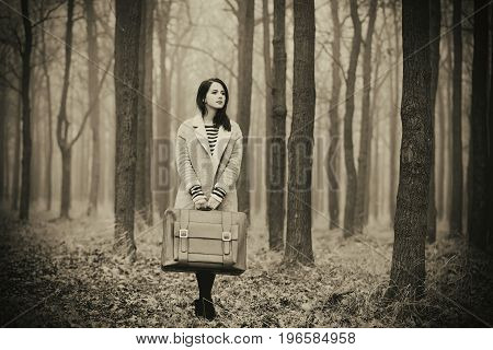 Portrait Of A Young Woman With A Suitcase