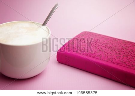 Closed Pink Bible On A Pink Background