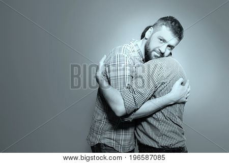 Gay couple on grey background