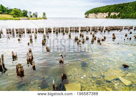 Remnants of docks in Fayette Historic Townsite in Michigan