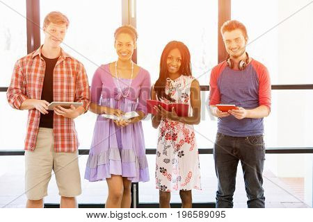 Group of students standing with books