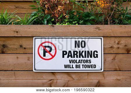 No parking violators will be towed sign