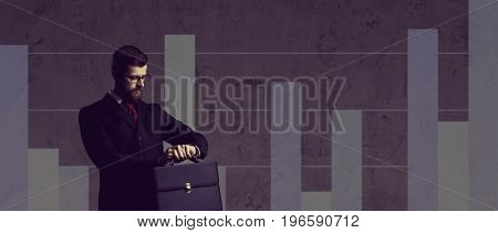 Businessman with briefcase standing over column diagram background. Business, office, career, job concept.