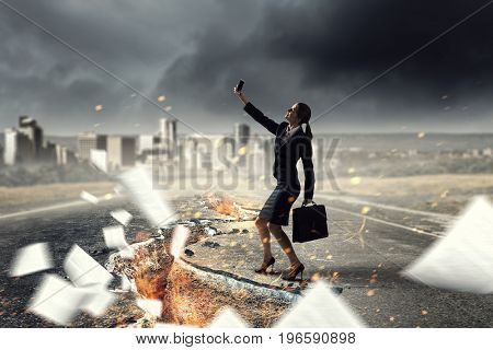 Businesswoman catching moment on her mobile