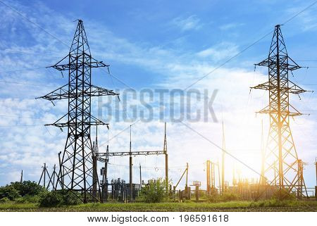 Field with electrical transmission towers and substation