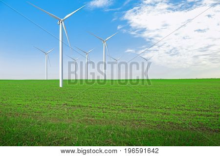 Wind turbines in field. Concept of eco friendly thechnology
