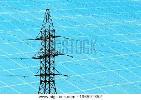 Electrical transmission tower and solar panels on background. Concept of eco friendly thechnology