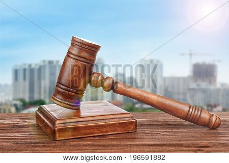 Judge's gavel on cityscape background. Concept of law