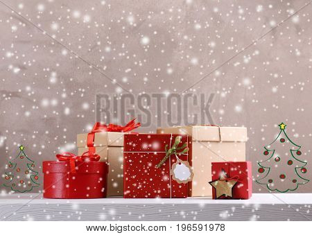 Gifts and drawings of Christmas trees on color background. Boxing day concept. Snow effect