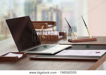 Workplace of lawyer in modern office with cityscape view through window