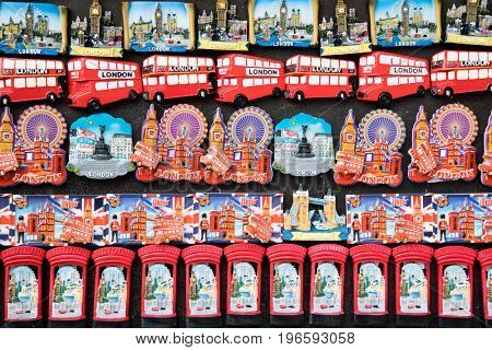 London, UK - 5 June 2017: Souvenir London fridge magnets displayed for sale. Iconic symbols of London with red double-decker buses, Houses of Parliament, pillar boxes, Tower Bridge and the London Eye.