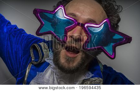 Man with beard dressed like a pirate and ridiculous glasses, funny and humorous, costume party