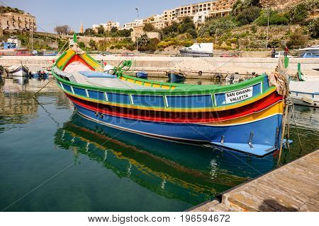 Mgarr, Malta - October, 2014: ships and boats in the Port of Mgarr