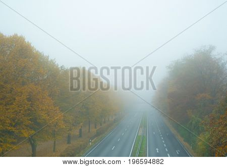 Autobahn in the fog in autumn
