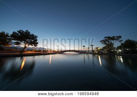 Pond in the park at night with blue sky