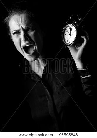 Stressed Woman Isolated On Black Background With Alarm Clock