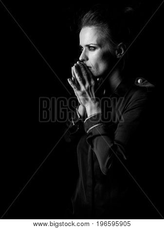 Pensive Woman In Dark Dress Isolated On Black Background