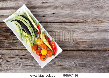 freshly harvested vegetable from the garden on rustic background