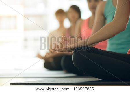 Young women yoga indoors keep calm and meditates while practicing yoga to explore the Inner Peace. Yoga and meditation have good benefits for health. Photo concept for Yoga Sport and Healthy lifestyle