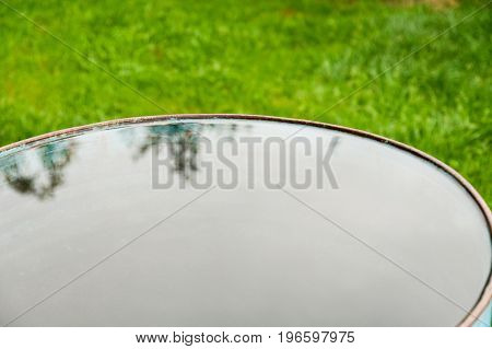 Smooth Water Surface In The Barrel Standing In The Yard