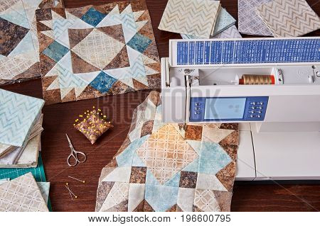 Sewing machine with patchwork block of quilt top view