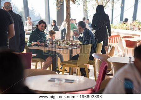 Young parents enjoying lunch time with their children at a luxury restaurant
